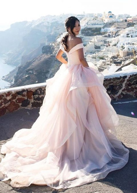 princess-style pink off the shoulder wedding gown with a full layered skirt plus a train