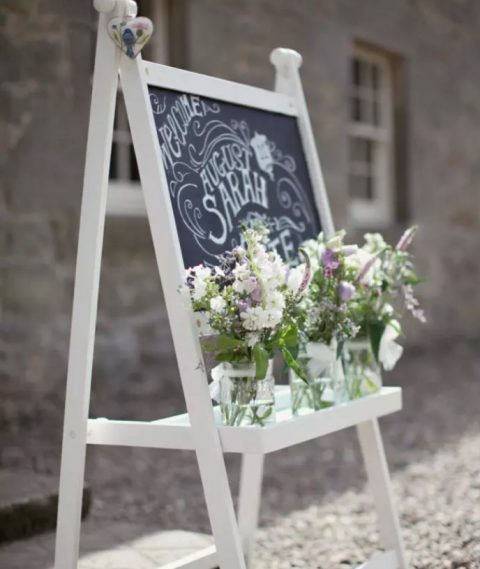 wedding signage with chalkboard and blooms using IKEA Mala easel