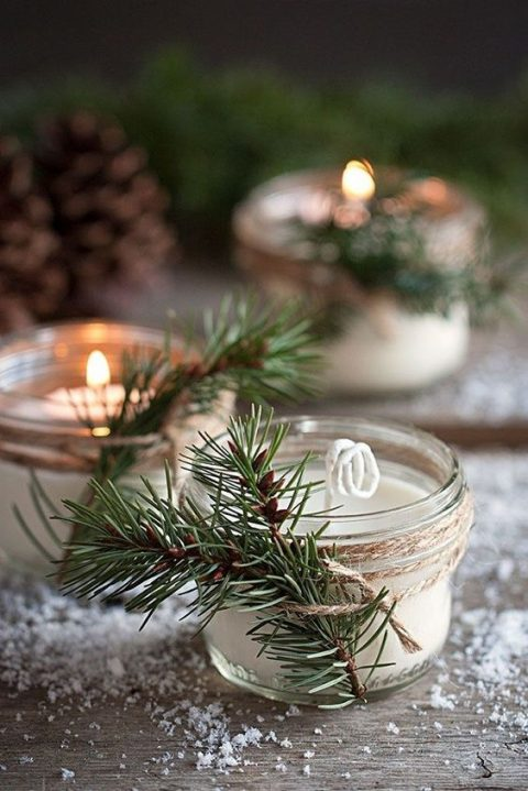 winter-scented DIY candles decorated with evergreens