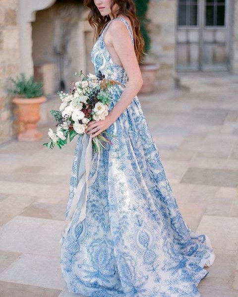 a blue floral wedding dress with thick straps and an A-line skirt is a romantic idea