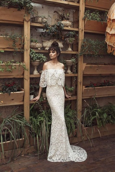 a boho lace sheath off the shoulder wedding dress with a small train