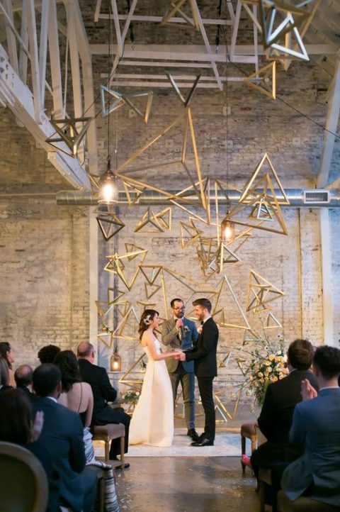a brass tetrahedral installation for the wedding ceremony