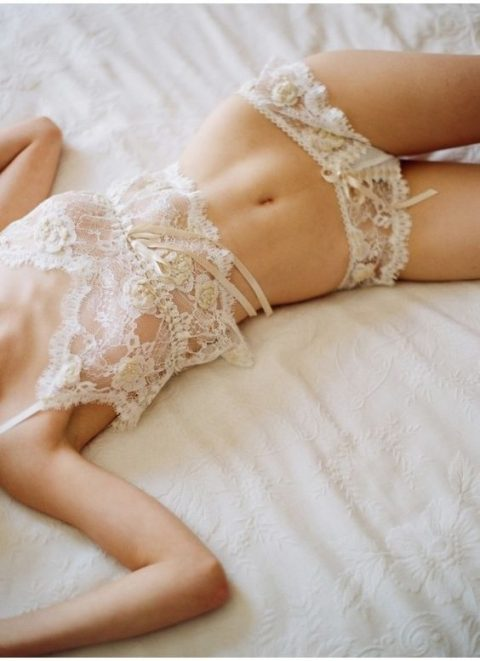 a delicate see-through lace top on spaghetti straps and panties