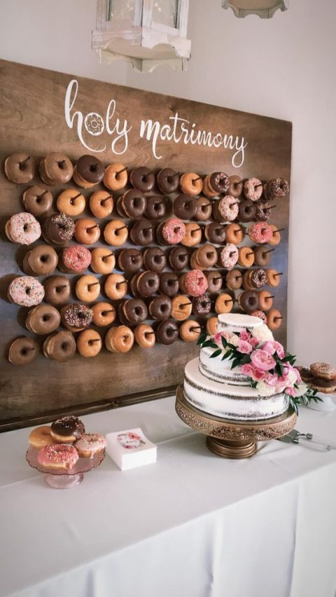 a donut wall is a trendy catering idea instead of a usual dessert table