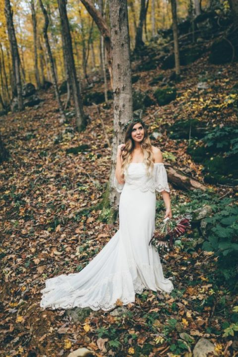 a flowy off the shoulder mermaid wedding dress with lace edges