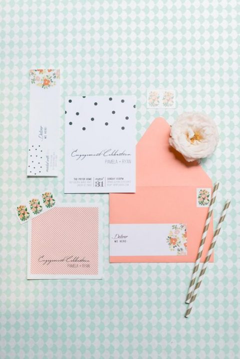 a fun wedding invitation suite with florals, polka dots and coral touches