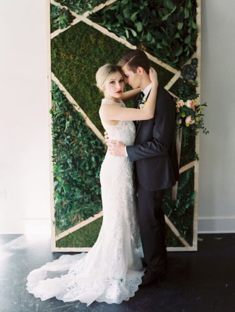 a geometric moss and greenery wedding backdrop
