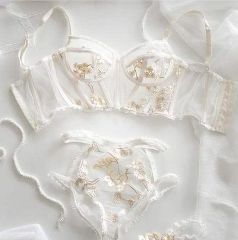 a heavenly sheer bridal lingerie set with gold floral lace appliques