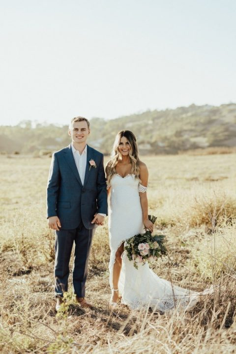 a lace off the shoulder wedding dress with a high low skirt and a train