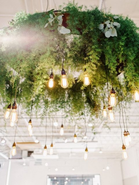 a large greenery wedding chandelier with lots of bulbs hanging down is a great idea for a reception or a dance floor