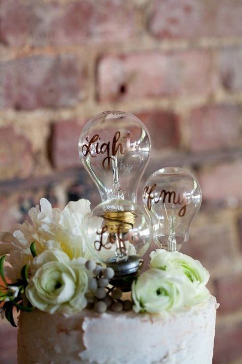 a light bulb cake topper with calligraphy is a creative idea for an industrial wedding