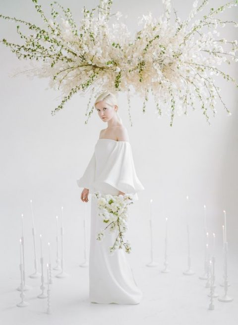 a lush white bloom overhead decoration looks heavenly