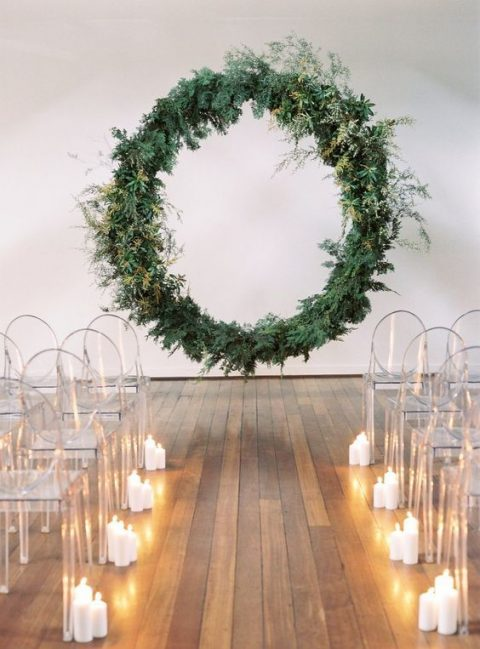 a modern fresh greenery wreath floating in the air