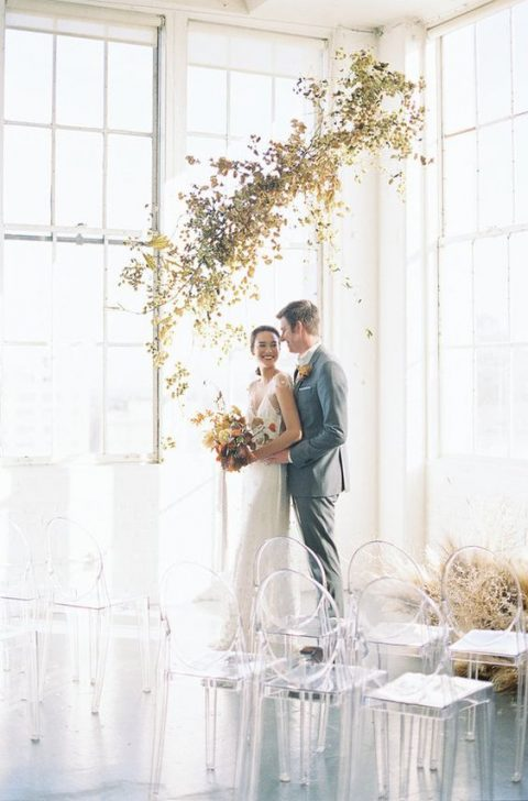 a modern wedding ceremony overhead decoration of gilded foliage for a spring wedding