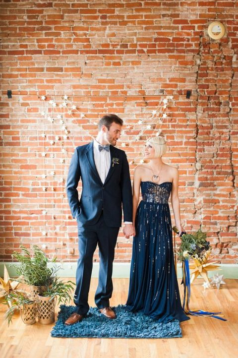 a navy strapless wedding dress with a heavily embellished bodice for a galaxy-inspired wedding