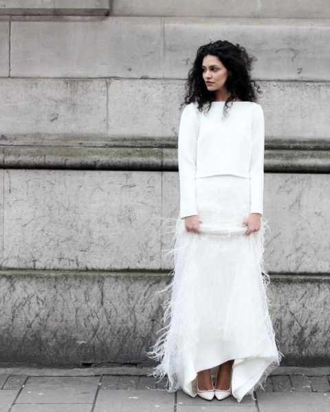 a plain white long sleeve top and a maxi white ostrich skirt for a minimalist bride