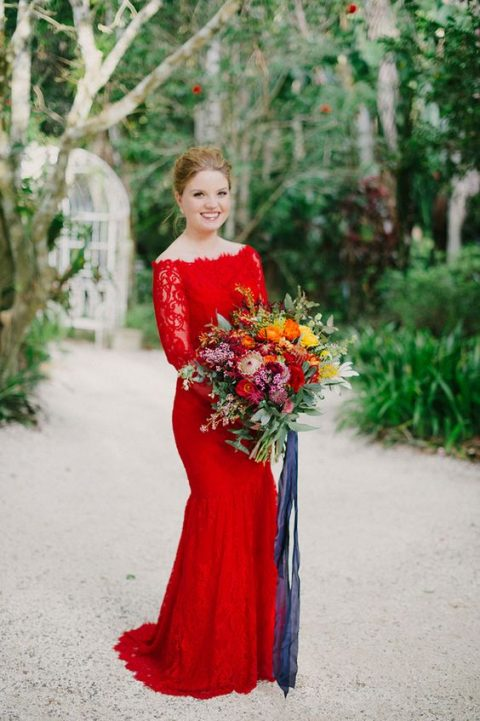 a red lace off the shoulder mermaid wedding dress