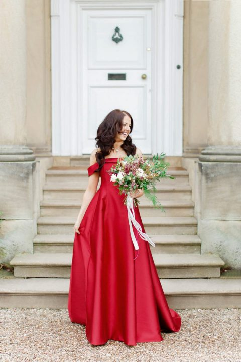 a red off the shoulder A-line plain wedding dress for a holiday wedding