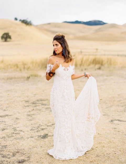 a romantic fit and flare boho lace off the shoulder wedding dress