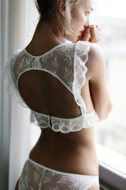 a sexy boho-inspired white lace lingerie set with a high neckline bra with a cutout on the back, ruffles and panties