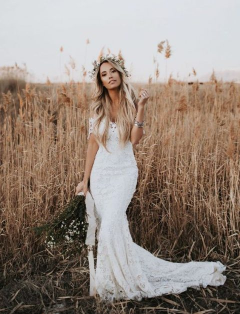 a sexy lace off the shoulder mermaid wedding dress with a small train