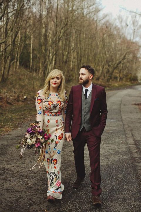a sheath wedding dress with colorful floral embroidery and a folksy feel