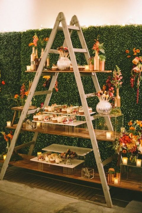 a stylish modern meets rustic dessert table on a ladder using acrylic stands