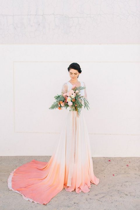 a wedding dress with a dip dyed ombre skirt in coral and pink