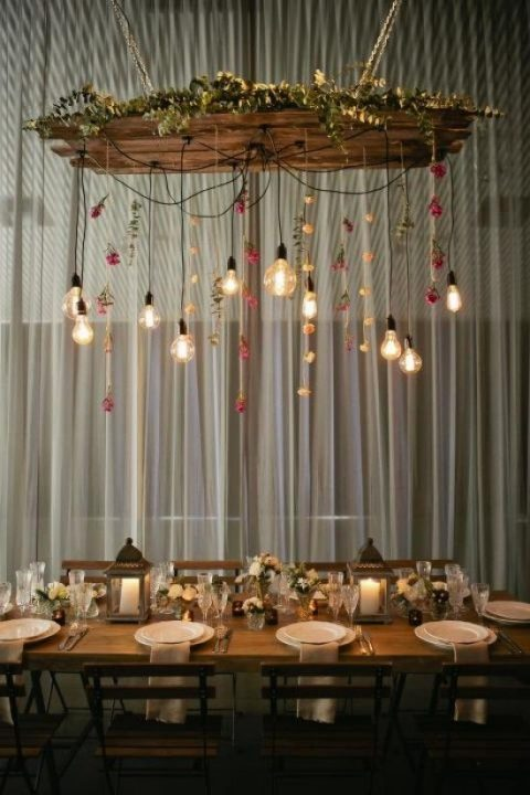 an overhead reception decoration with some eucalyptus, blooms and bulbs hanging down