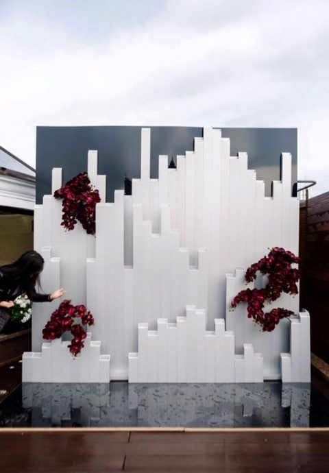 an ultra modern wedding backdrop inspired by Icelandic landscapes and with burgundy orchids for a touch of color