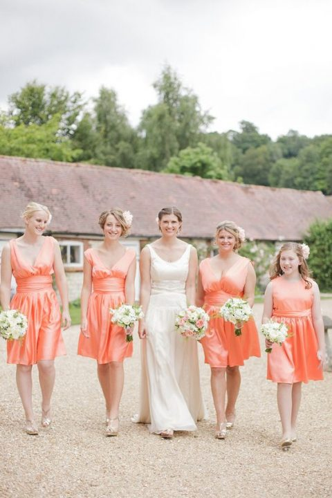 coral silk knee bridesmaid dresses with draped bodices and V-necklines