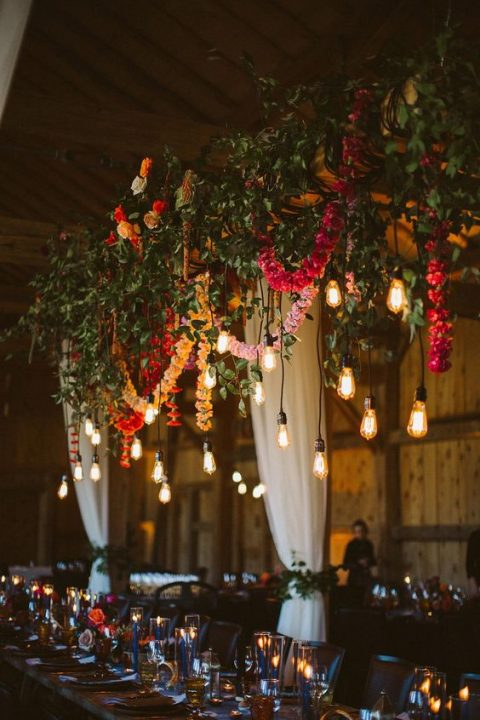 gorgeous overhead wedding decor with fresh greenery, colorful flower garlands and bulbs hanging down