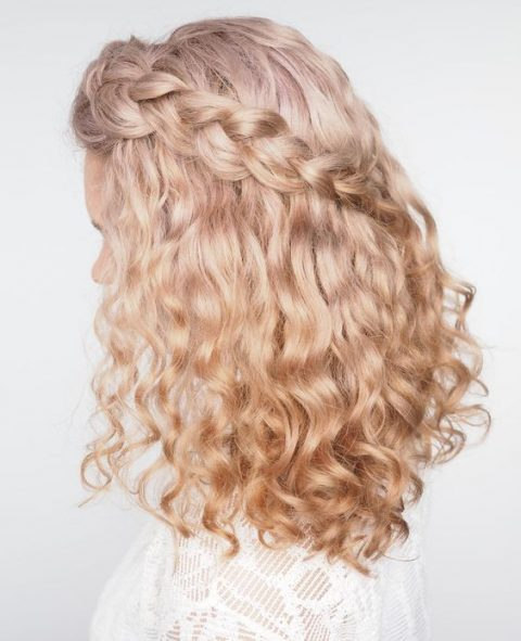 a charming curly half updo with a diagonal braid