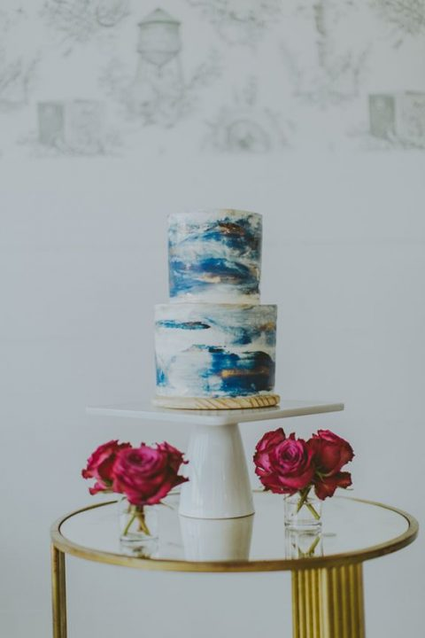 a chic blue brushstroke handpainted wedding cake for a beach wedding