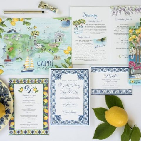 a colorful yellow and blue wedding invitation suite with a handpainted map