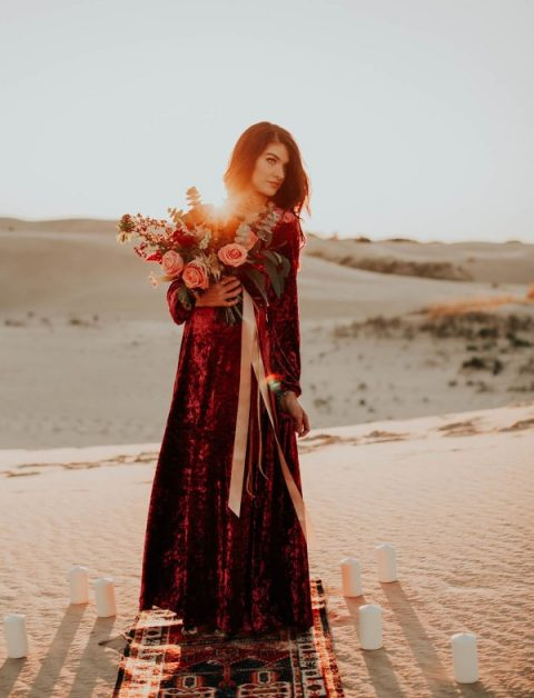 a crushed velvet burgundy maxi wedding dress with long sleeves