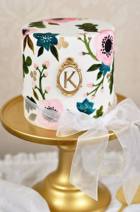 a floral handpainted wedding cake with a refined monogram