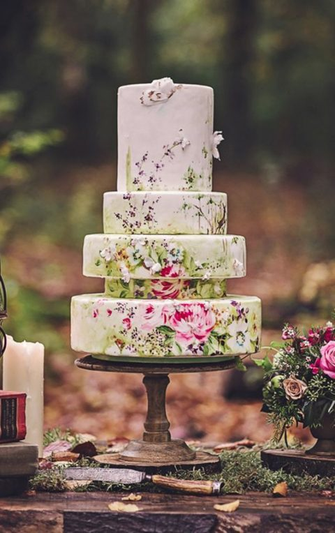 a handpainted floral wedding cake with a catchy structure