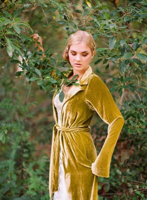 a mustard velvet coverup with long sleeves and a sash