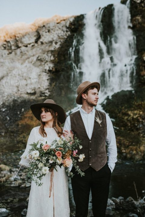 both guys wearing brown hats for their mountain elopement