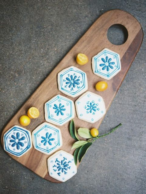 colored azulejo-style hexagon cookies for the dessert table
