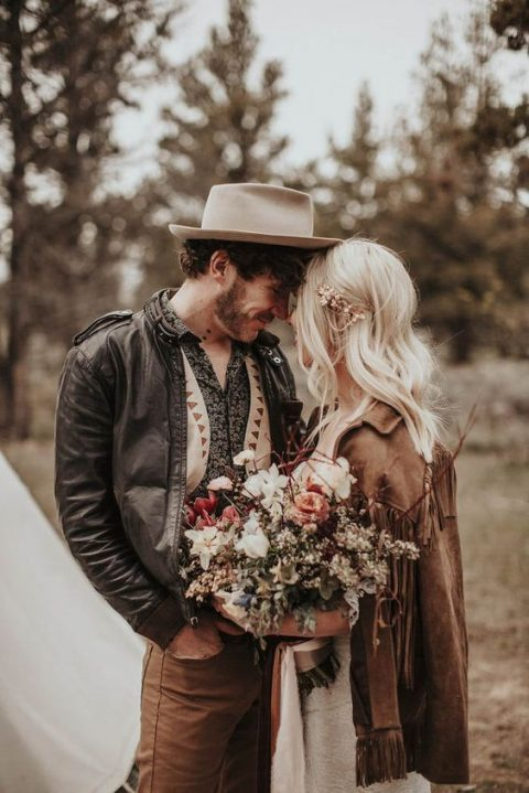 fringed leather jackets and a hat for a boho groom