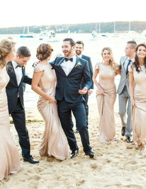glam bridesmaids wearing gold sequin sheath dresses with cap sleeves