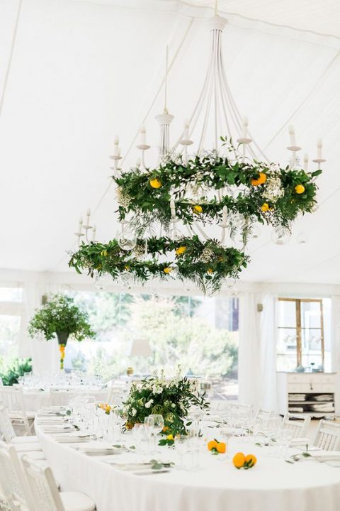 greenery and citrus chandeliers and matching centerpieces for a Mediterranean feel
