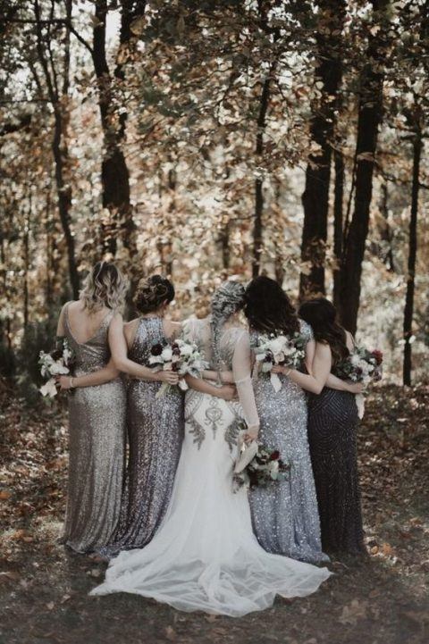 mismatched silver sequin sheath bridesmaid dresses and a black embellished gown for the maid of honor