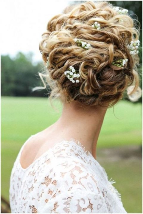 raise your curly hair into a comfy and chic updo and add soe blooms