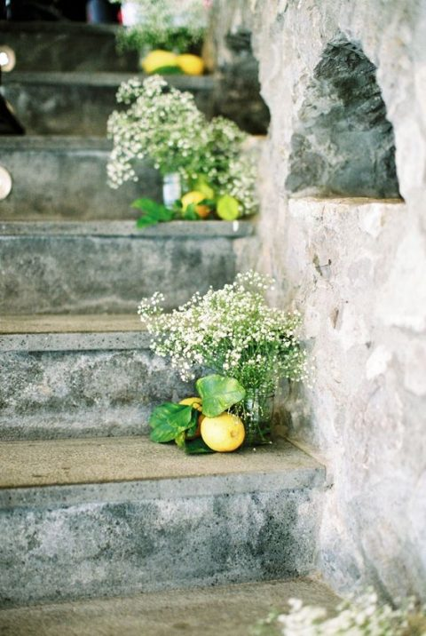 the wedding steps lined up with baby_s breath and lemons for a Mediterranean look