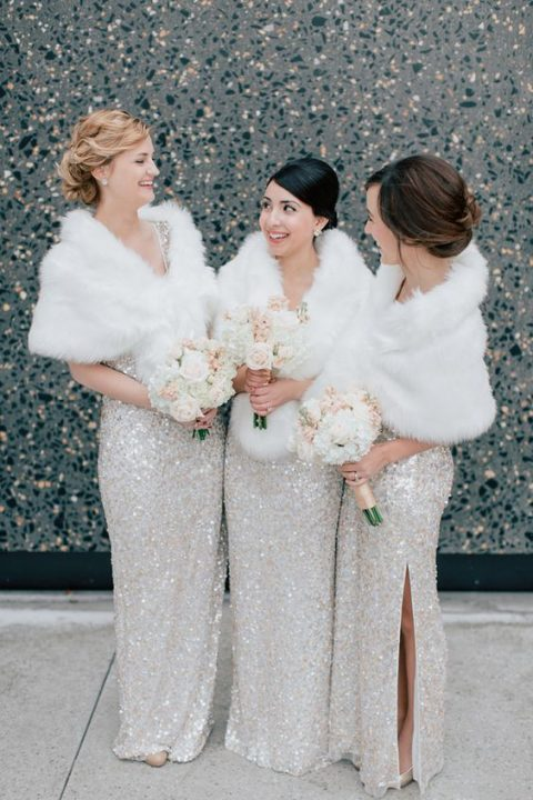 white and silver sequin dresses with faux fur stoles look sophisticated and timeless