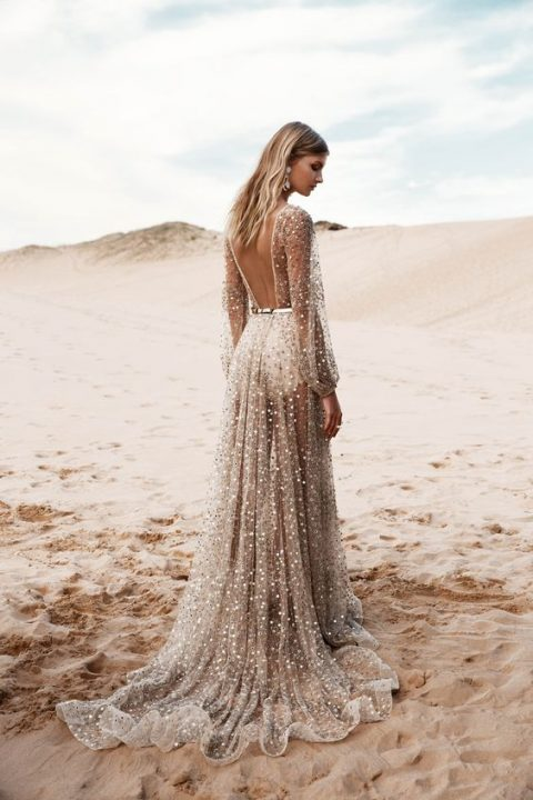Nala wedding dress by One Day Bridal with a cutout back, a train and sheer everything