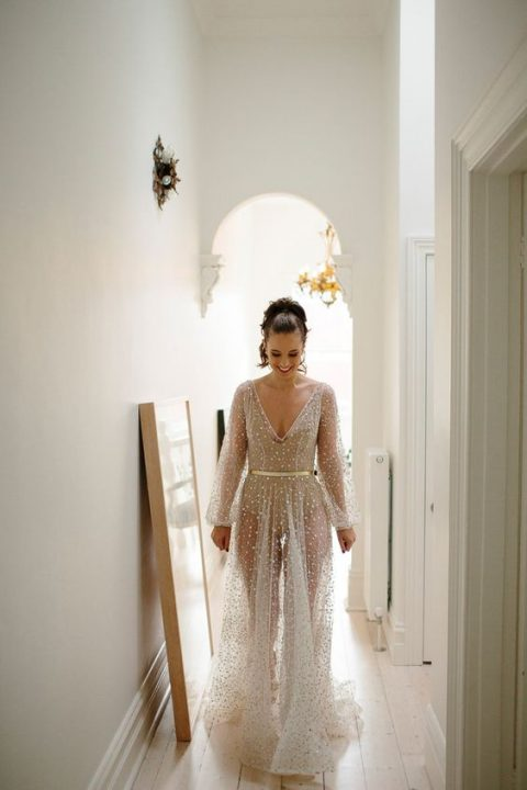 Nala wedding gown in white is a sheer sparkling dress with a bodysuit underneath
